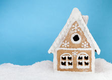Homemade gingerbread house on blue background Royalty Free Stock Photos