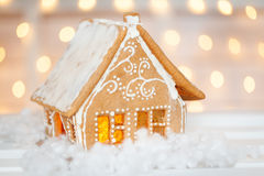 Homemade gingerbread house. With christmas lights on background Stock Images