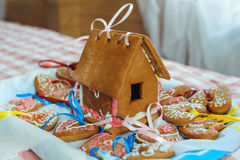 Homemade gingerbread house. And decorated gingerbread hearts for wedding and Valentine`s day Stock Images