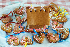 Homemade gingerbread house. And decorated gingerbread hearts for wedding and Valentine`s day Stock Photo
