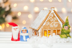 Homemade gingerbread house. With felt Santa Claus, Snow-maiden and Christmas tree Stock Image