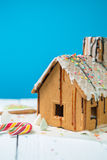 Homemade gingerbread house with glaze and confectionery sprinkling. Royalty Free Stock Photo