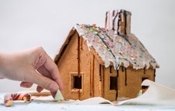 Homemade gingerbread house with glaze and confectionery sprinkling Stock Photos