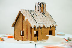 Homemade gingerbread house with glaze and confectionery sprinkling. Stock Photos