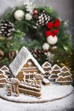 Homemade gingerbread house. Little homemade gingerbread house with Christmas decorations stock photo