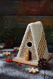 Homemade gingerbread house with pine branches, cones and biscuits on dark background. European Christmas traditions. Xmas holiday Royalty Free Stock Photography