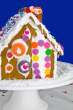 Homemade Gingerbread House on a White Cake Stand Royalty Free Stock Photo