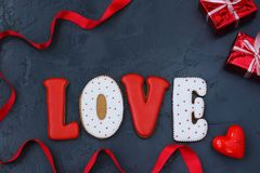 Homemade gingerbread with letters `love` for Valentine`s Day stock photos