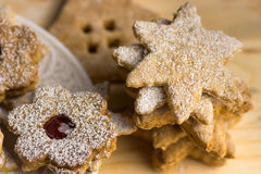 Homemade gingerbread and linzer cookies with jam, powdered, in different shapes, on a wood board, soft light, close up, Stock Photography