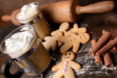 Homemade gingerbread men and coffee Stock Images