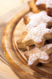 Homemade gingerbread  star cookies on wood Stock Photos