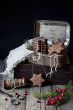 Homemade gingerbread star shaped cookies for Christmas on vintage box Stock Photo
