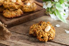 Homemade gluten free cookies. Made of mashed sweet potato, chia seeds and almonds on rustic wooden table stock image