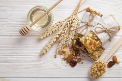 Homemade gluten free granola bars on wooden background. Royalty Free Stock Photos