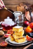 Homemade gluten-free polenta, almond and blood orange cake. Homemade gluten-free polenta, almond and sicilian blood orange cake on rustic background Royalty Free Stock Images