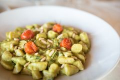 Homemade gnocchi is a italian pasta made of potato. With basil and tomato sauce stock photography