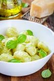 Homemade gnocchi with pesto sauce, parmesan and basil Stock Photography