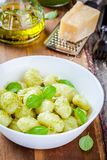Homemade gnocchi with pesto sauce, parmesan and basil Stock Images