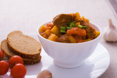 Homemade goulash with slices of bread Stock Images