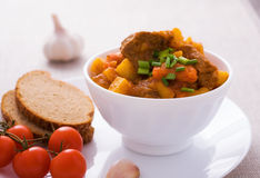 Homemade goulash with slices of bread Royalty Free Stock Images