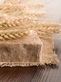Homemade grain soap. Homemade natural grain soap on wood background stock photos
