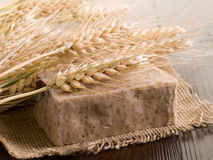 Homemade grain soap. Homemade natural grain soap on wood background royalty free stock images