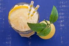 Homemade granita from fresh lemons. Glass with homemade granita from fresh organic lemons Royalty Free Stock Images