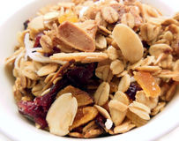 Homemade granola. Close-up of bowl full of homemade granola with almonds, oats, cranberries, apricot and coconut Royalty Free Stock Photo