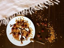 Homemade granola at black table with some milk Royalty Free Stock Images