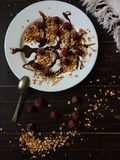 Homemade granola at black table with some milk Royalty Free Stock Photo