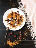 Homemade granola at black table with some milk stock photography