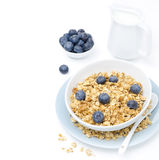 Homemade granola, blueberries and jug of milk, isolated on white Stock Image