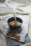 Homemade granola in a bowl with milk. Shot of a homemade granola in a bowl with milk royalty free stock photos