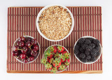 Homemade Granola and Cherries, Strawberries, and Blackberries on Royalty Free Stock Image