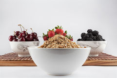 Homemade Granola and Cherries, Strawberries, and Blackberries in Royalty Free Stock Image