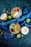 Granola with chia seeds yogurt, fresh fruit and berries royalty free stock photography