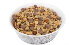 Homemade granola with chocolate drops isolated on white backgrou Royalty Free Stock Image