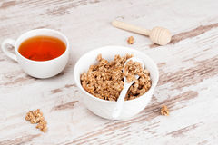 Homemade granola and cup of tea Royalty Free Stock Images