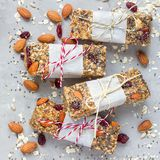 Granola energy bars with figs, oatmeal, almond, dry cranberry, chia and sunflower seeds, square format Royalty Free Stock Photo