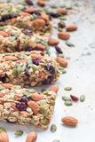 Homemade granola energy bars with figs, oatmeal, almond, dry cranberry and pumpkin seeds, healthy snack, copy space. Vertical Royalty Free Stock Photo