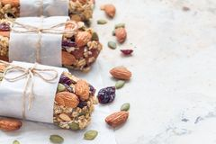 Homemade granola energy bars with figs, oatmeal, almond, dry cranberry and pumpkin seeds, healthy snack, copy space. Horizontal Stock Image