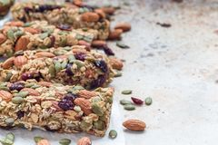 Homemade granola energy bars with figs, oatmeal, almond, dry cranberry and pumpkin seeds, copy space, horizontal. Homemade granola energy bars with figs, oatmeal Royalty Free Stock Image