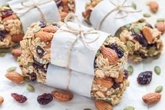 Homemade granola energy bars with figs, oatmeal, almond, dry cranberry and pumpkin seeds, healthy snack. Horizontal Royalty Free Stock Photos