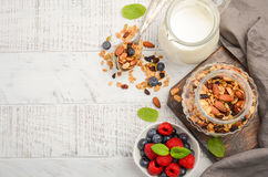 Homemade granola with fresh berries on white wooden background Stock Images