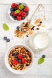 Homemade granola with fresh berries on white wooden background Royalty Free Stock Photography