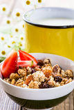 Homemade granola with fresh strawberry and mug of milk Stock Photos