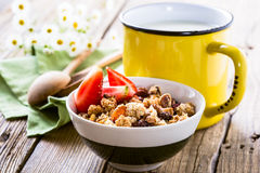 Homemade granola with fresh strawberry and mug of milk. Healthy breakfast, healthy lifestile Royalty Free Stock Photos