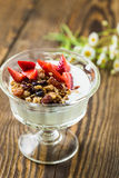 Homemade granola with fresh strawberry over vanilla yogurt Stock Photos