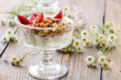 Homemade granola with fresh strawberry over vanilla yogurt Royalty Free Stock Images