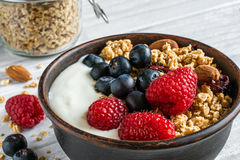 Homemade granola with greek yogurt, nuts and fresh berries Royalty Free Stock Photos